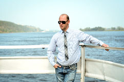 Man in shirt. Standing near the water Stock Photos