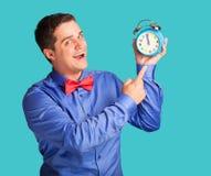 Man in shirt with alarm clock Stock Photo