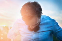 Man in a shirt with a beard is tilting her head sunny natural  background close up Royalty Free Stock Photography