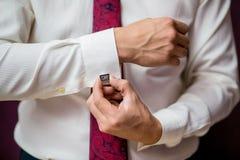 A man in a shirt button cufflink closeup.  stock image