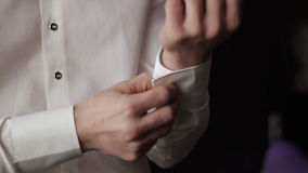 Man in a shirt with cufflinks stock video footage