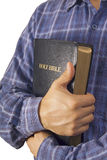 Man in a shirt embracing Bible Royalty Free Stock Images