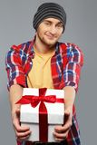 Man in shirt with gift box Stock Images