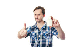 The man in a shirt holds in hand gel after shaving Royalty Free Stock Images
