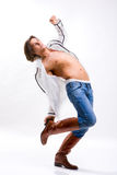 Man in shirt, jeans and boots. Denuded torso Stock Image