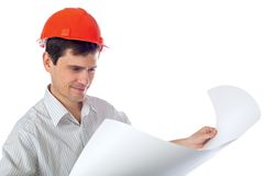 Man in a shirt orange construction helmet with Royalty Free Stock Photo
