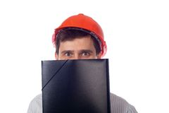 Man in a shirt orange construction helmet covers Royalty Free Stock Images