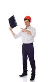 Man in a shirt orange construction helmet with one. Man in a shirt in orange construction helmet with one hand holding a black folder and points a finger isolate Royalty Free Stock Photography