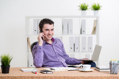 Man in shirt on phone Royalty Free Stock Photography
