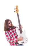 Man in shirt playing bass guitar Stock Image