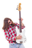 Man in shirt playing electric bass guitar Stock Photography