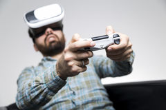 Man in shirt playing vr game with controller Royalty Free Stock Photography