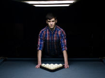 Man in shirt prepare for start game of billiard. With triangle Royalty Free Stock Image
