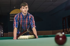 Man in shirt prepare for start game of billiard Stock Image