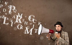 Man in shirt shouting into megaphone and text come out Royalty Free Stock Photo