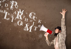 Man in shirt shouting into megaphone and text come out Royalty Free Stock Photos
