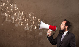 Man in shirt shouting into megaphone and text come out Royalty Free Stock Photography