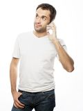Man in shirt speaking on the phone Royalty Free Stock Image