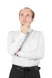Man in shirt thinking, hand on chin, isolated Royalty Free Stock Photo