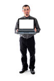Man in shirt and tie holding laptop smiling Royalty Free Stock Photos