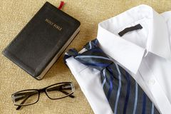 Man shirt with tie and Holy Bible stock photos
