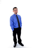 Man in shirt and tie looking up. hands in pockets Royalty Free Stock Images