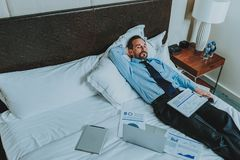 Tired businessman sleeping with documents by his side royalty free stock images