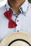 Man in shirt with untied bow-tie and wicker hat Stock Photos