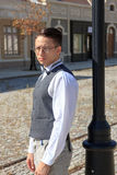 Man in shirt and vest with bow tie and glasses, standing leaning Stock Image