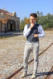 Man in shirt and vest with bow tie and glasses, standing in line Royalty Free Stock Photo