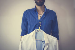A man and shirt. Young man in shirt white backgroun Royalty Free Stock Image