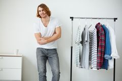 Man and shirts Stock Image