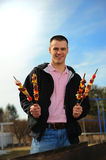Man with a shish kebab Stock Images