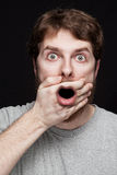 Man in shock after finding secret news. Man in shock after finding amazing secret news royalty free stock photography