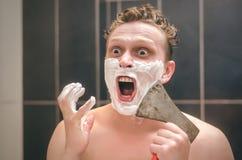 Man shaving by axe. stock photos