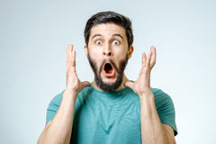 Man with shocked, amazed expression. On gray background Stock Images