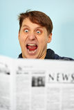 Man shocked - bad news from newspaper Stock Photo