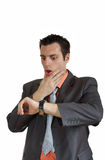 Man shocked looking at wrist watch Stock Photography