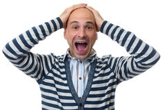 Man shocked to madness with his hands on head Royalty Free Stock Images
