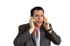 Man shocked with two telephones Stock Photography
