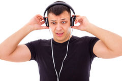 Man shocked by what he hears on headphones Stock Photography