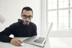Man Shocked while working on computer in office Stock Photography