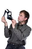 The man with a shoe. The man with footwear on a white background Stock Photo