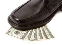 Man shoe on money Royalty Free Stock Photo