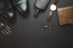 Man shoes, belts and perfume. Shoes belts perfume on the black accessory Royalty Free Stock Images