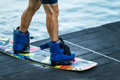 Man for shoes boards wakeboard closeup concept sports stock image