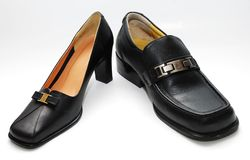 Man shoes and lady shoes. Focus a man shoes and lady shoes image on the white background Stock Photos