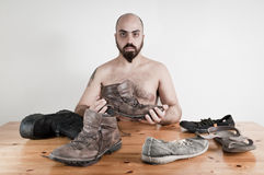 Man and shoes on the table conceptual Stock Photography