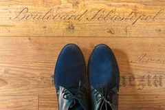 Man shoes view from above. Man's shoes view from above on wood floor Royalty Free Stock Photo