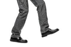 Man in shoes walking step. Business man in black shoes walking for next achievement or promotion step white isolated Royalty Free Stock Photos